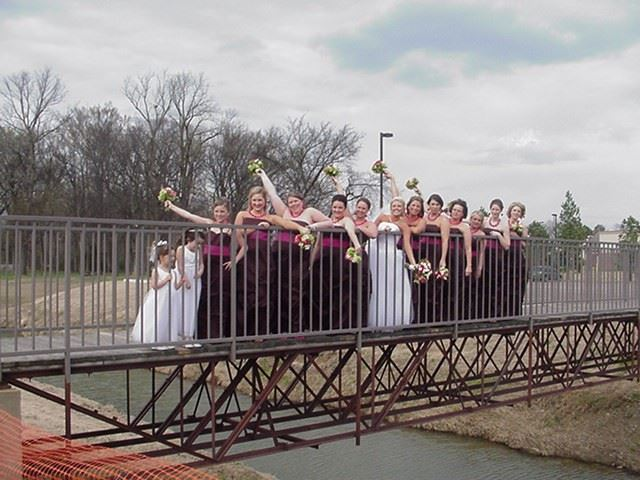 Bridesmaids on foot bridge
