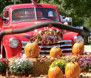 old truck with pumpkin