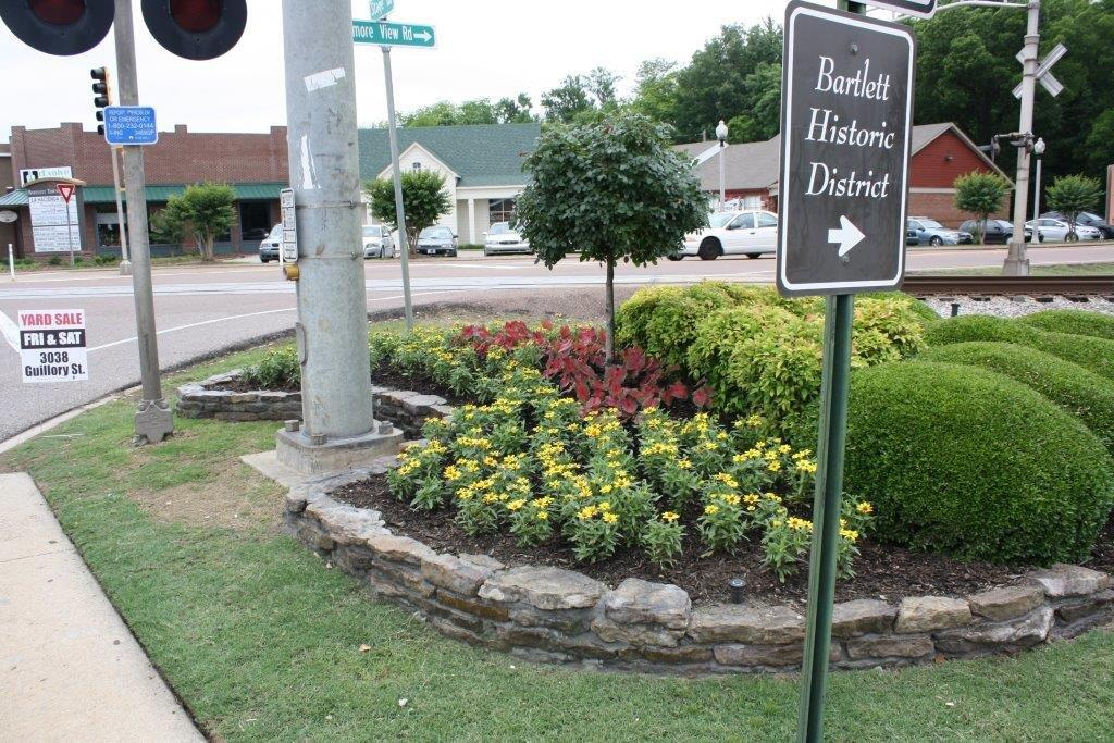 Flower bed by the Bartlett Historic District Sign