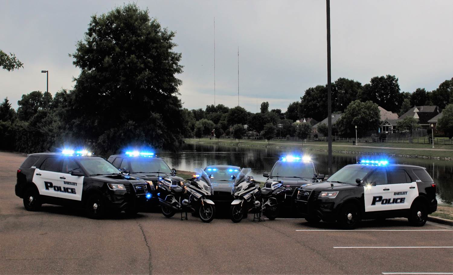 Patrol Vehicles and motorcycles parked together
