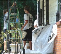 Local church volunteers paint a home in the Horton subdivision