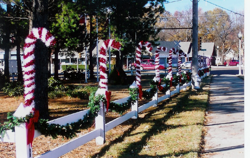 park fence decorated for christmas